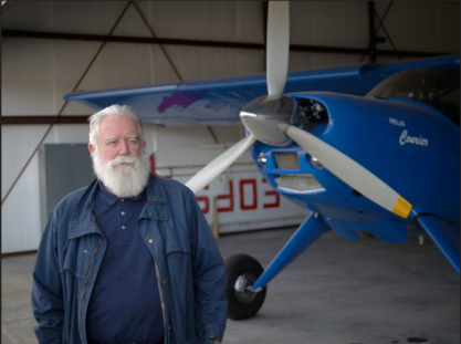 James Turrell next to his vintage Helio Courier